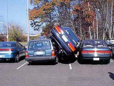 Parking Space Between Car And Sidewalk