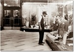 man+vintage+suit+shopping+window+fedora