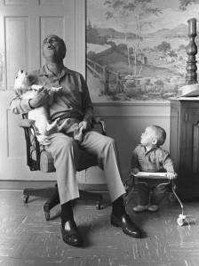 LBJohnson-singing with his dog in front of his grandson