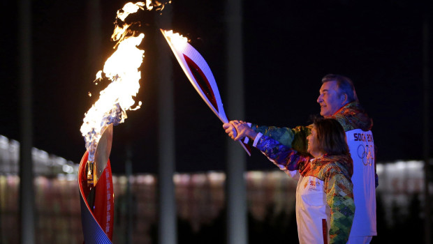 Former hockey player Tretiak and figure skater Rodnina light the Olympic Cauldron during the opening ceremony of the 2014 Sochi Winter Olympics