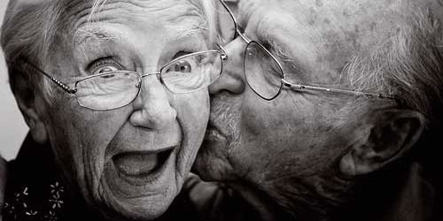 Old Couple Kissing by Capital FM