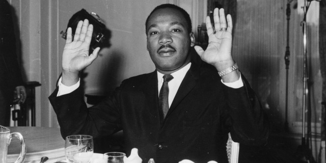 Martin Luther King and his hands up Huffington Post