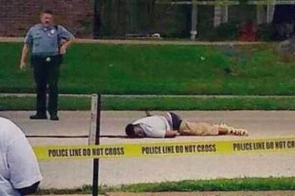 Michael Brown dead in the street in Ferguson, Missouri