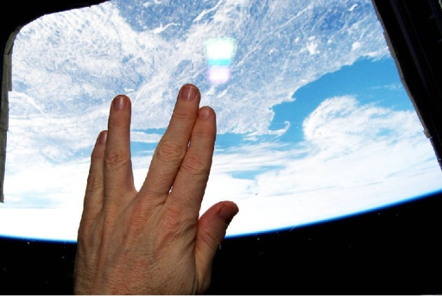 NASA International Space Station astronaut Terry Virts salutes as tribute to Leonard Nemoy somewhere over Cape Cod
