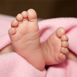 Babys Feet sticking out from underneath covers - see attribution