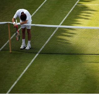 Exhausted Tennis Player at the Net
